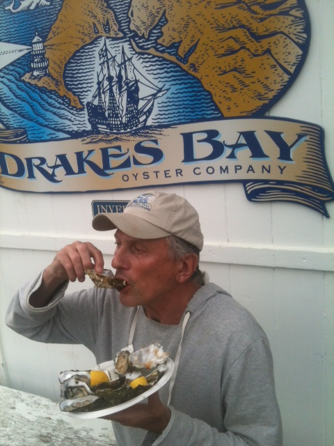 Publisher enjoying the spoils of Drake's Bay Oysters. Photo by Shaun Fenn